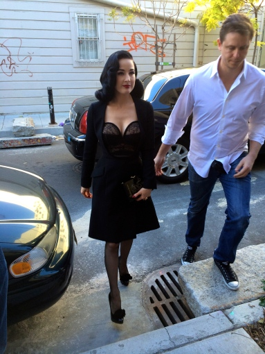 Dita getting out of the car. Look how tiny her legs are!